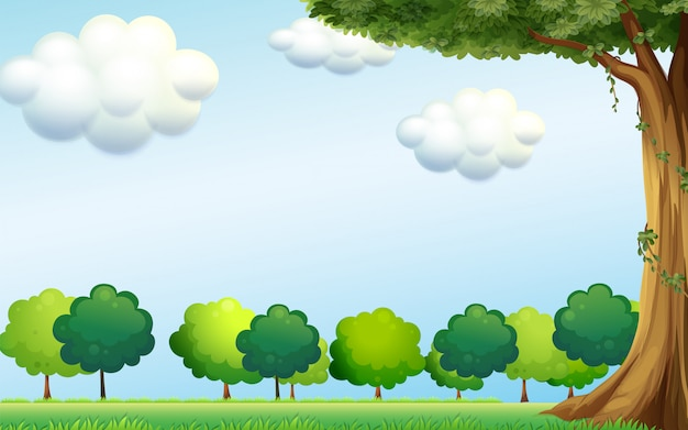 A clear blue sky and the green trees Free Vector