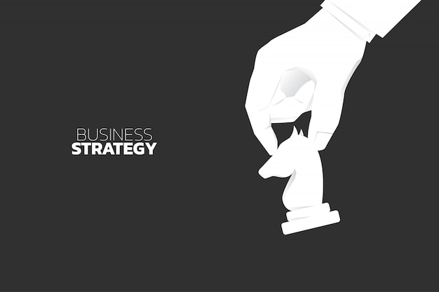 Close up hand move knight chess piece. concept of business strategy and marketing plan Premium Vector