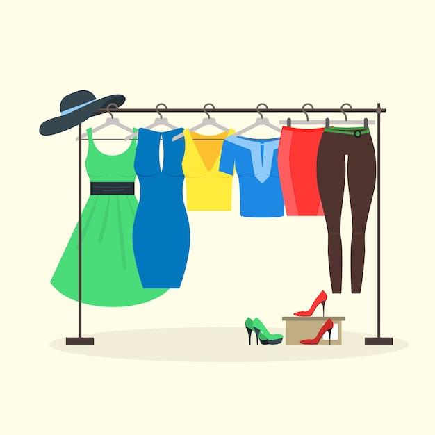 女性がハンガーに着用する洋服ラック Premiumベクター