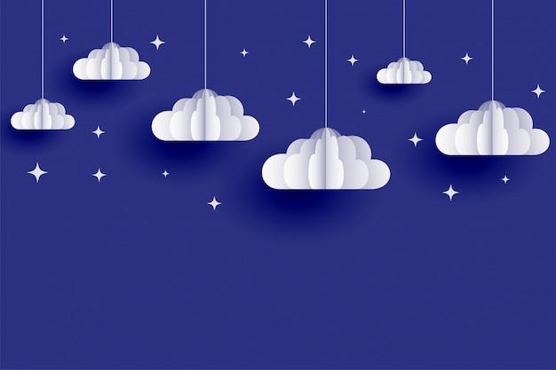 Фон облаков и звезд в стиле papercut Бесплатные векторы