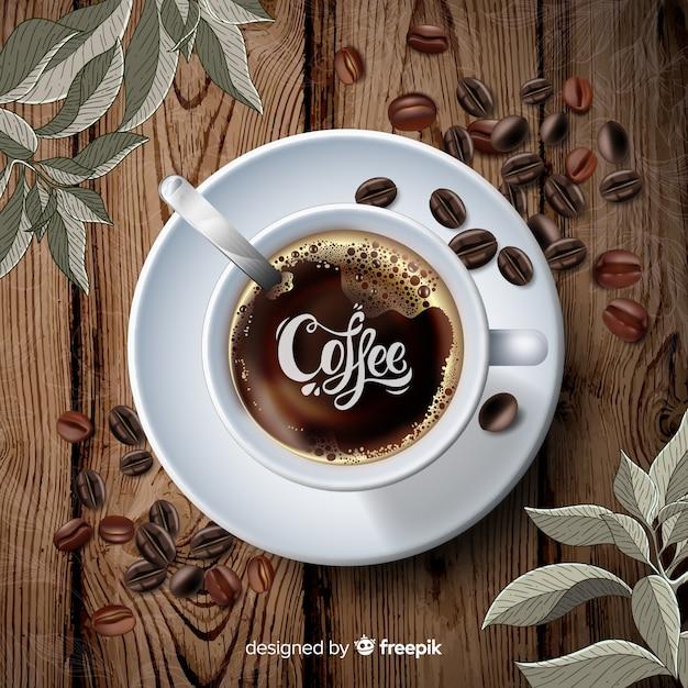 コーヒーカップと豆の背景 無料ベクター