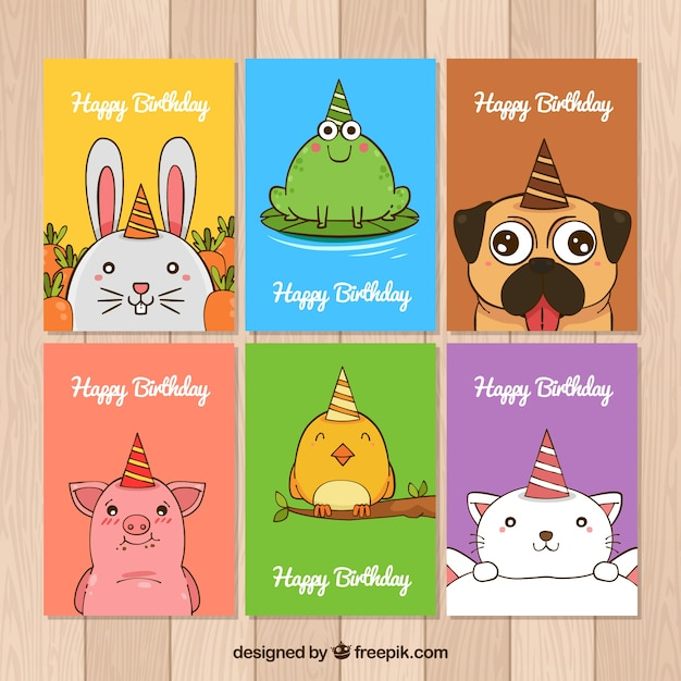 Collection of birthday cards with hand drawn animals Free Vector
