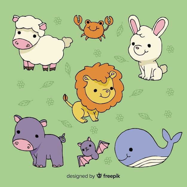 Collection of cute animals on green background Free Vector