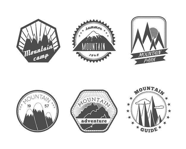 A collection of decorative round and polyangular snowy mountains summer camp labels isolated vector illustration Free Vector