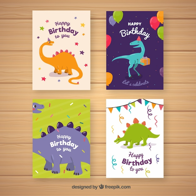 Collection of four birthday cards with dinosaurs Free Vector