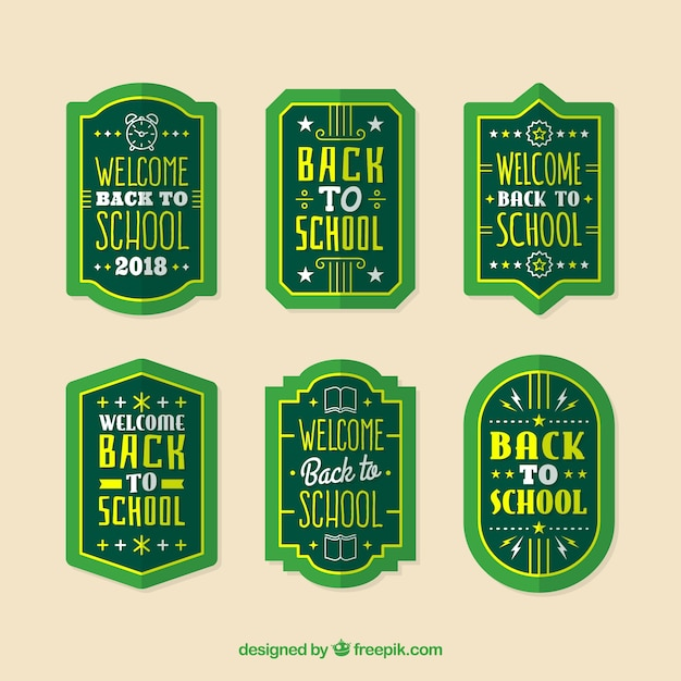 Collection of green back to school labels Free Vector