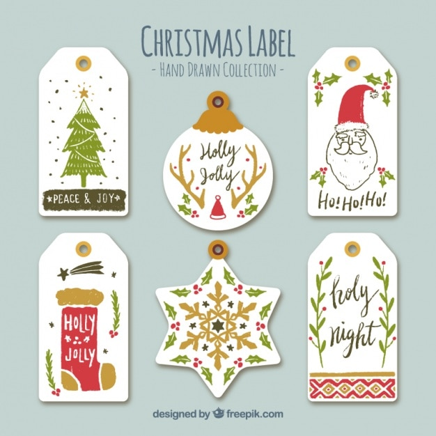Collection of hand drawn cute christmas stickers Free Vector