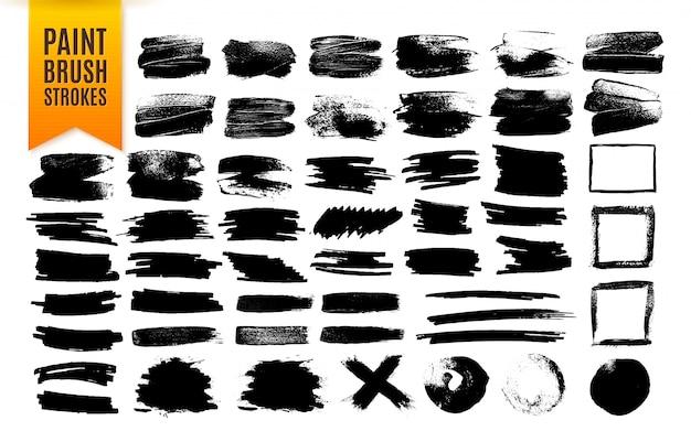 黒のペイントブラシストローク、グランジ効果要素のコレクション。 Premiumベクター