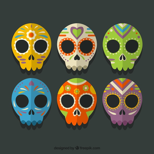 Collection of colored mexican skulls Free Vector