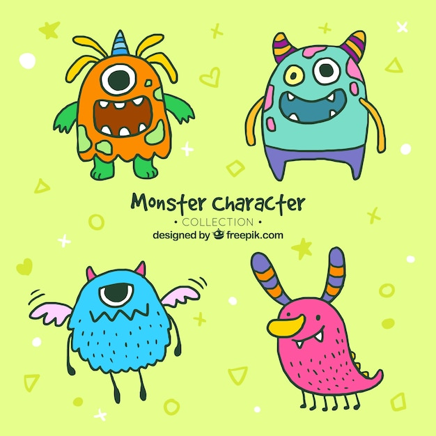 Collection of hand drawn monsters Free Vector