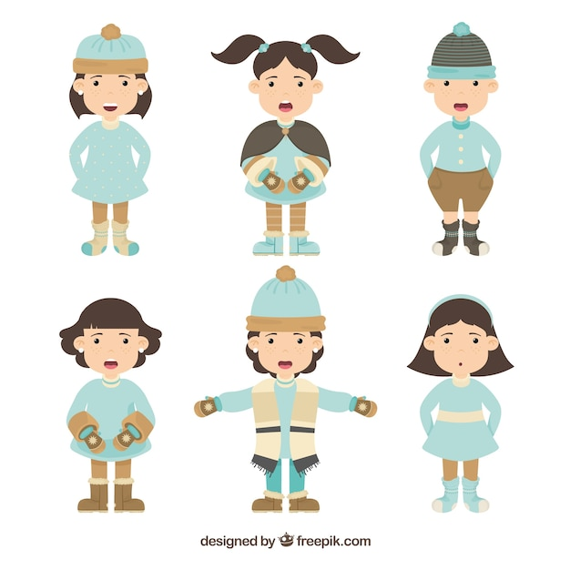 Collection of kids wearing blue winter clothes