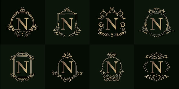 豪華な飾りや花のフレームが付いたロゴのイニシャルnのコレクション Premiumベクター