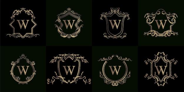 고급 장식 또는 꽃 프레임이있는 로고 이니셜 W 컬렉션 프리미엄 벡터