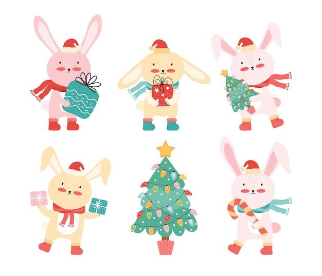 クリスマスツリーとギフトとサンタの帽子のウサギのコレクション Premiumベクター