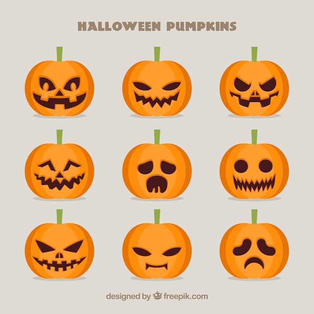 Collection of spooky pumpkins for halloween Free Vector
