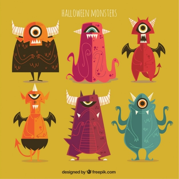 Collection of vintage halloween monsters in design Free Vector
