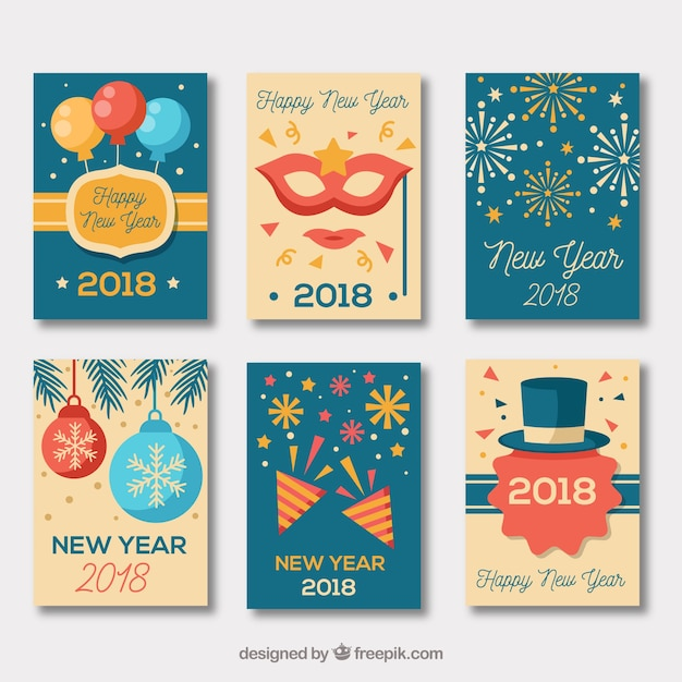collection of vintage new year cards in blue and beige free vector