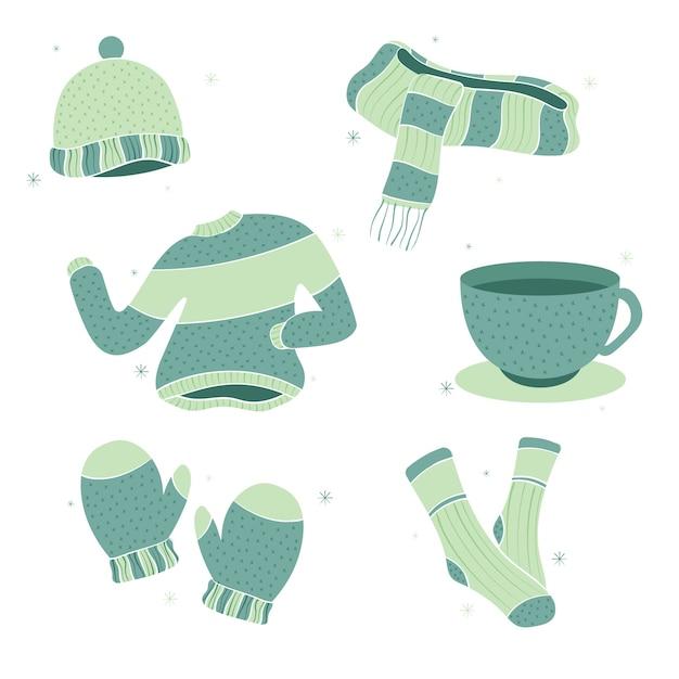Коллекция зимней одежды рисованной Бесплатные векторы