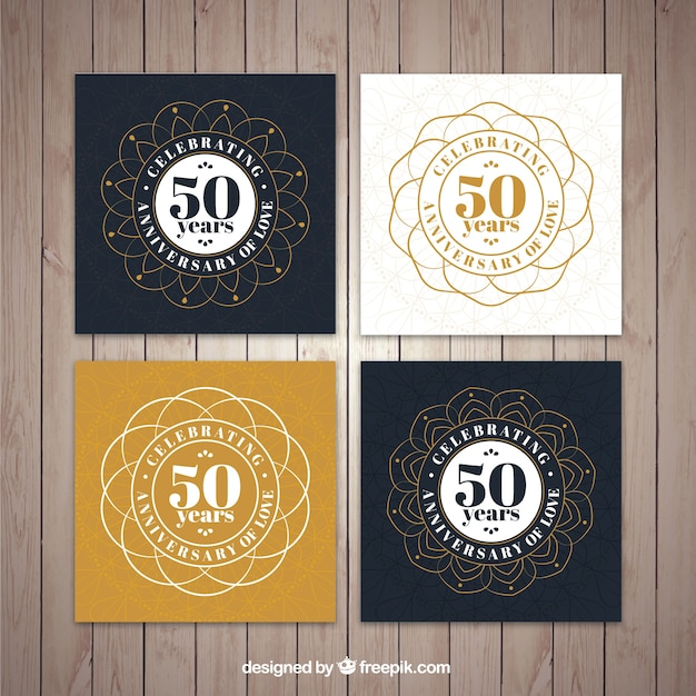 Collection of ornamental golden wedding card Free Vector