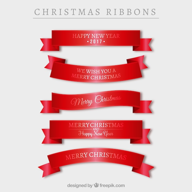 Collection of red ribbons with christmas messages Free Vector