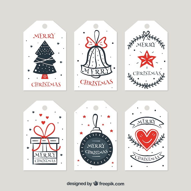 Collection of retro hand drawn christmas tags Free Vector