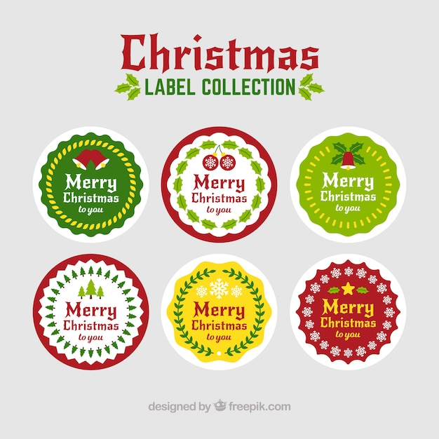 Collection of round christmas labels Free Vector