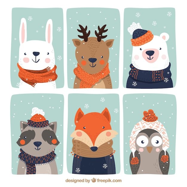 Collection of six beautiful animals with winter clothes Free Vector
