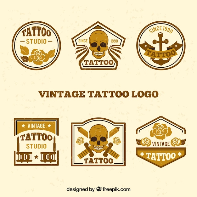 Collection of vintage golden tattoo logo Free Vector