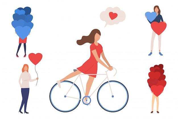 Collezione di giovani donne con palloncini a forma di cuore Vettore gratuito