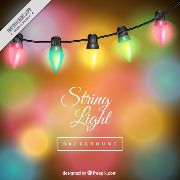Colored bokeh background with string lights Free Vector