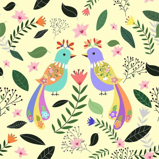 花と葉の背景を持つカラフルなカップルの鳥 Premiumベクター
