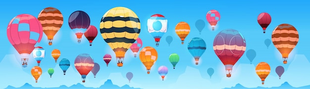 Colorful air balloons flying in day sky banner Premium Vector