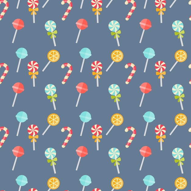 Colorful candy seamless background pattern on blue with festive candy canes Free Vector