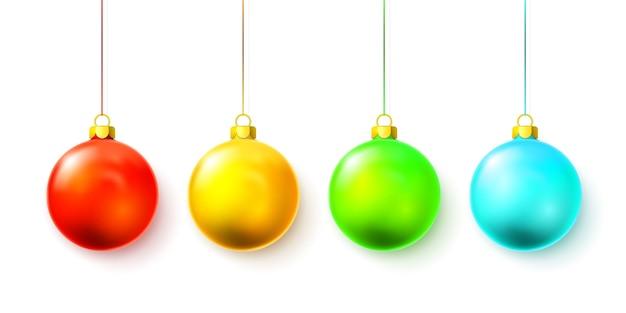 白で隔離のカラフルなクリスマスボール Premiumベクター