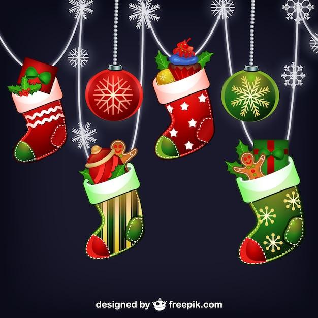 Colorful christmas socks Free Vector