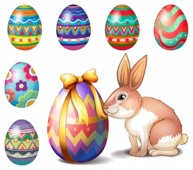Colorful easter eggs and a bunny Free Vector