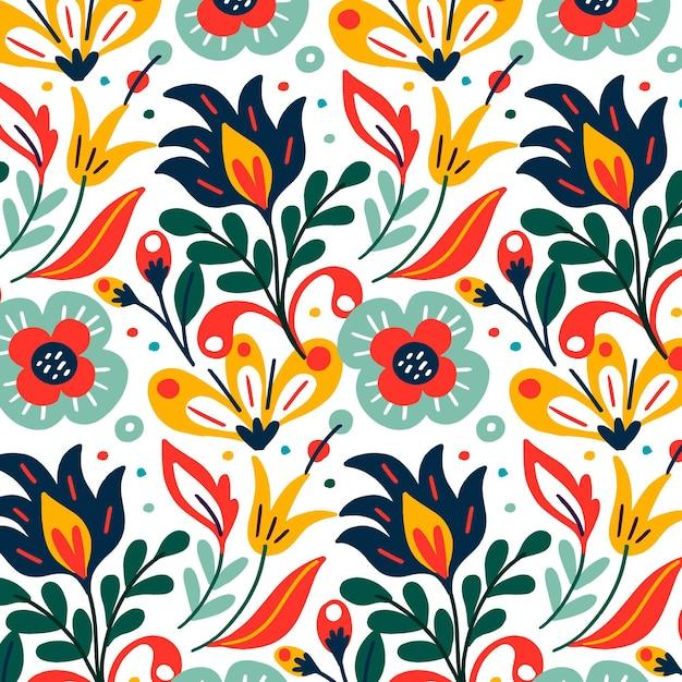Modello esotico colorato di foglie e fiori Vettore gratuito