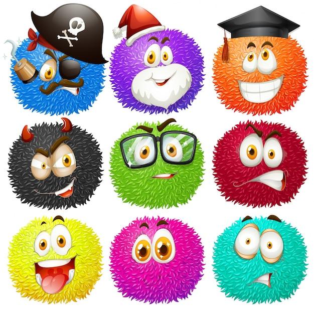 Красочные пушистые шарики с лицами Бесплатные векторы