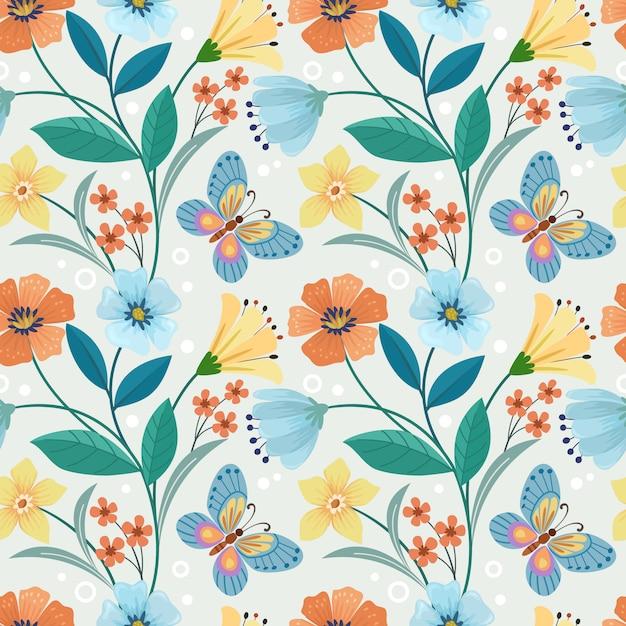 カラフルな手描きの花と蝶のシームレスパターン Premiumベクター