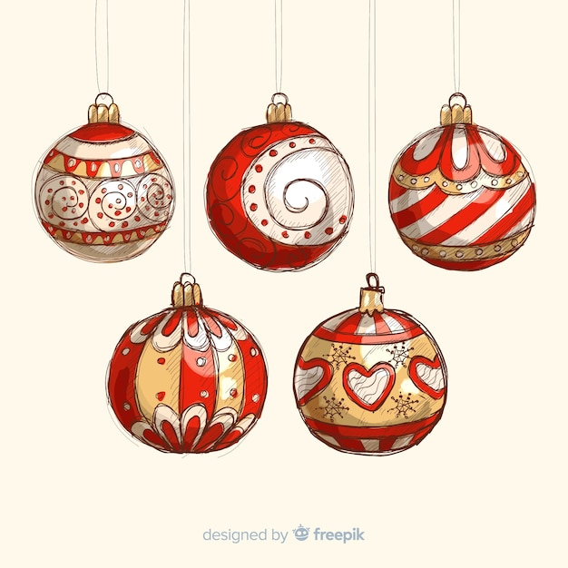 Colorful hand drawn christmas balls Free Vector