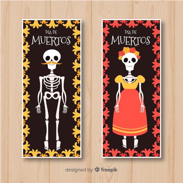 Colorful hand drawn día de muertos banners Free Vector