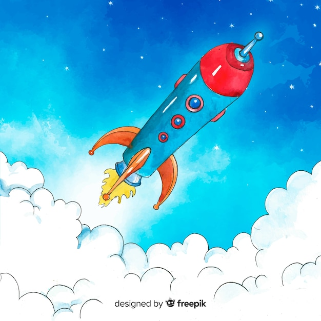 Colorful hand drawn rocket Free Vector