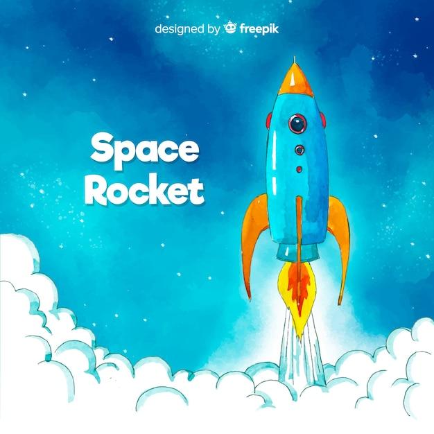 Colorful hand drawn rocket Free Vector