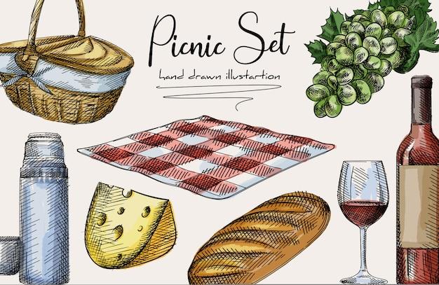 Красочный рисованный эскиз набора для пикника. в набор входят корзина, сыр, буханка хлеба, бутылка и бокал вина, термос и кружка, клетчатое одеяло, виноград. красочный набор Premium векторы