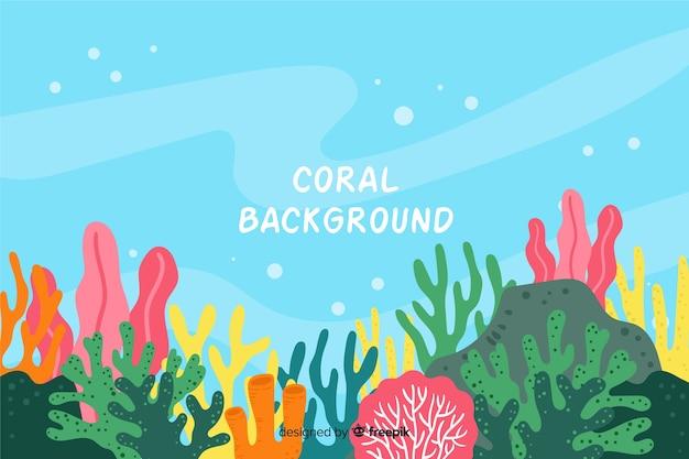 カラフルな手描きの水中サンゴの背景 Premiumベクター