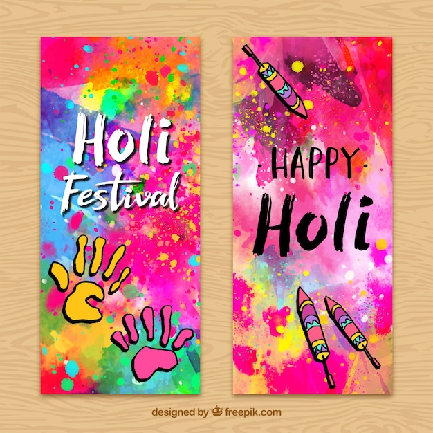 Colorful holi banners with hands and fireworks