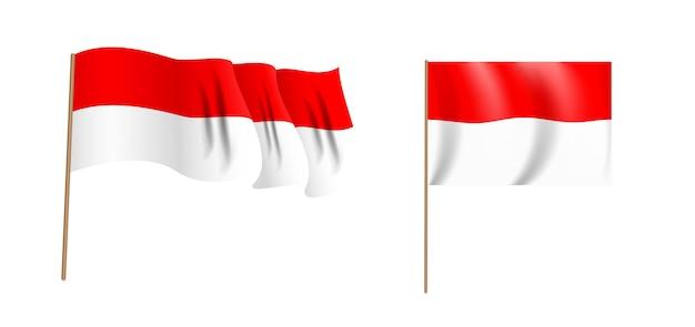 インドネシア共和国のカラフルな自然主義的な手を振る旗。 Premiumベクター