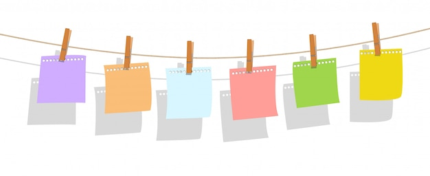 Colorful note paper hanging on burlap rope with wood Premium Vector