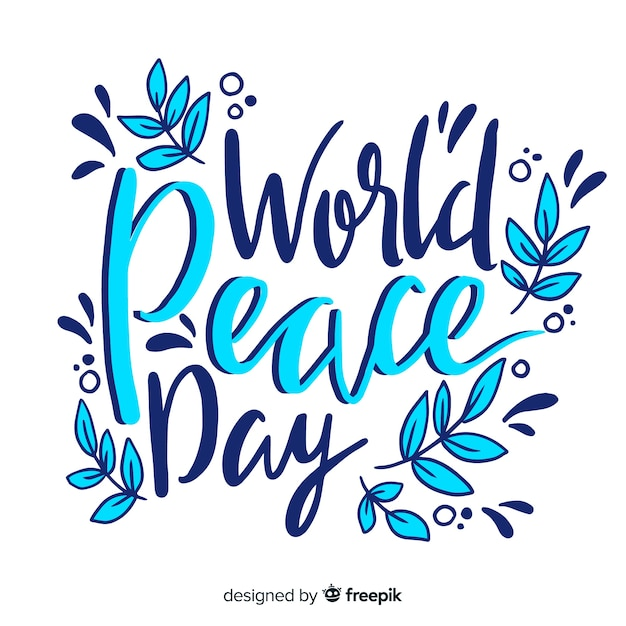 Colorful peace day lettering background Free Vector