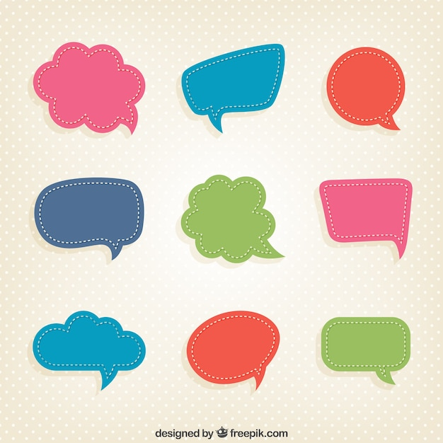 Colorful speech bubbles in cut-out style Free Vector